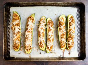 zucchini boats on a sheet pan after baking
