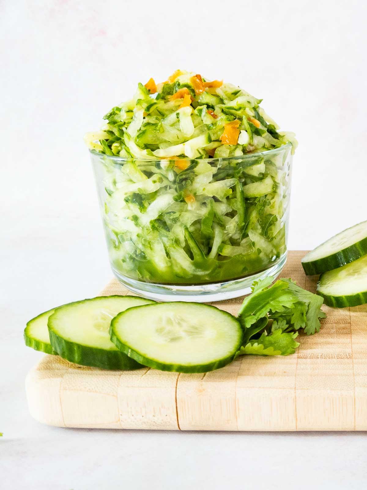 cucumber chutney in bowl on cutting board