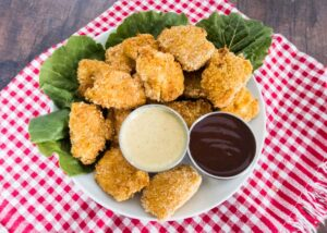 gluten free chicken nuggets on a plate with dipping sauces