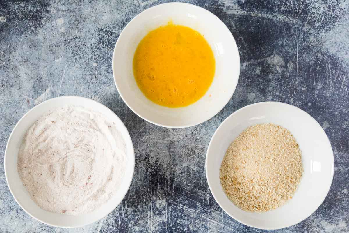 bowls with rice flour, egg wash and panko
