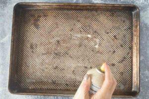 brushing oil on baking tray