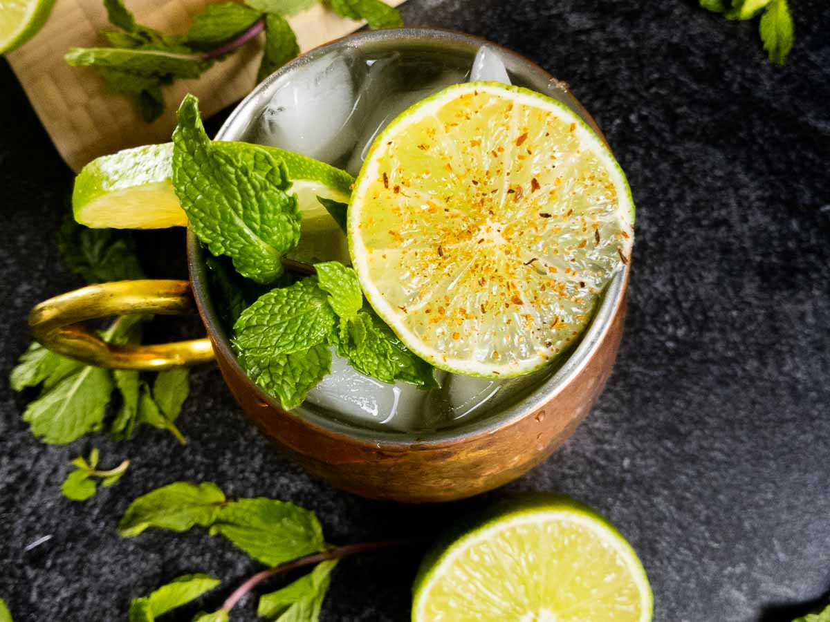 Close up of spicy mezcal mule with cayenne lime wheel