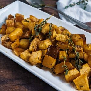 rutabaga on serving plate garnished with thyme