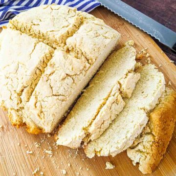 soda bread on cutting board with slices cut