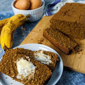slices of banana bread with butter on white plate