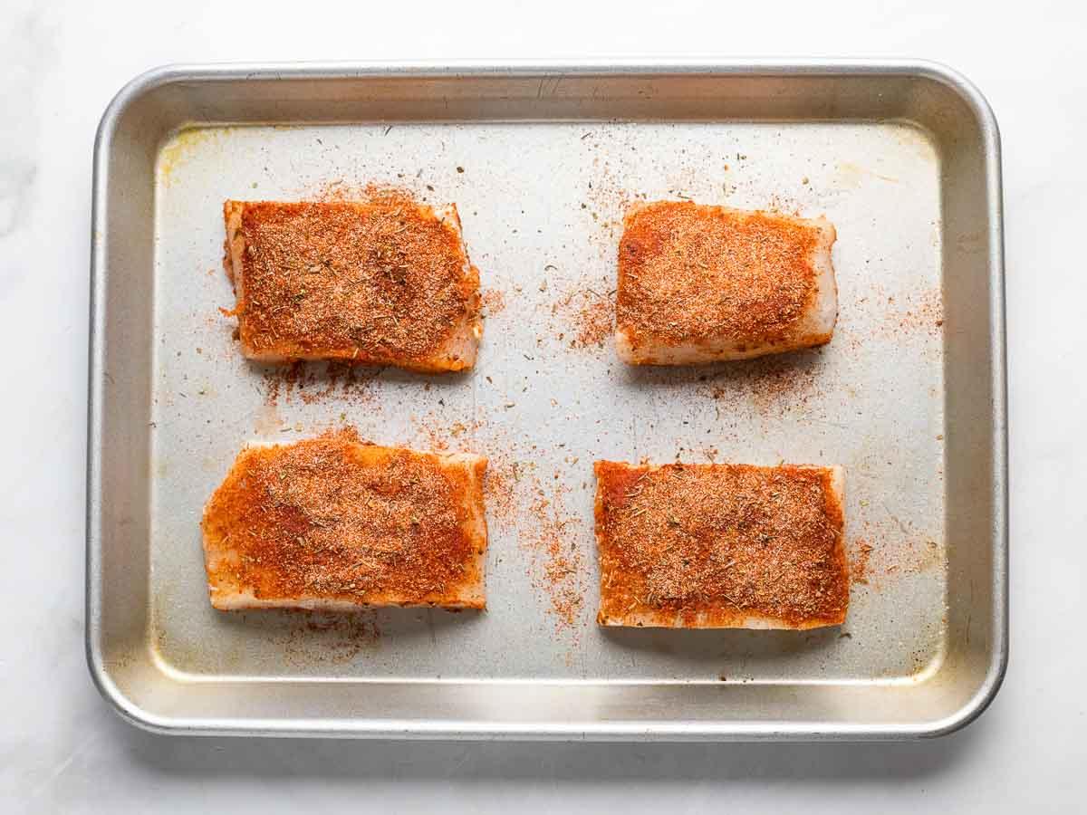 cod with cajun seasoning on sheet pan