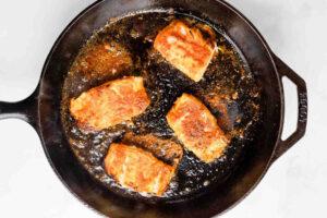 cod cooking in skillet