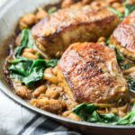 pork chops with spinach in a pan