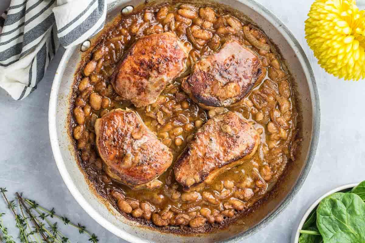 pork chops simmering in sauce