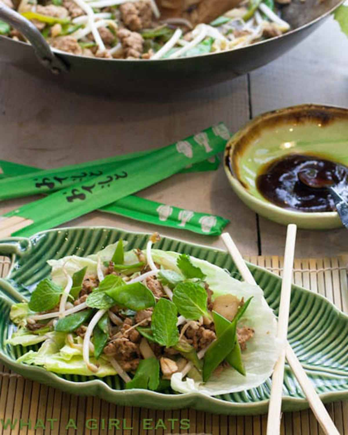ground turkey lettuce wrap on a plate with chopsticks