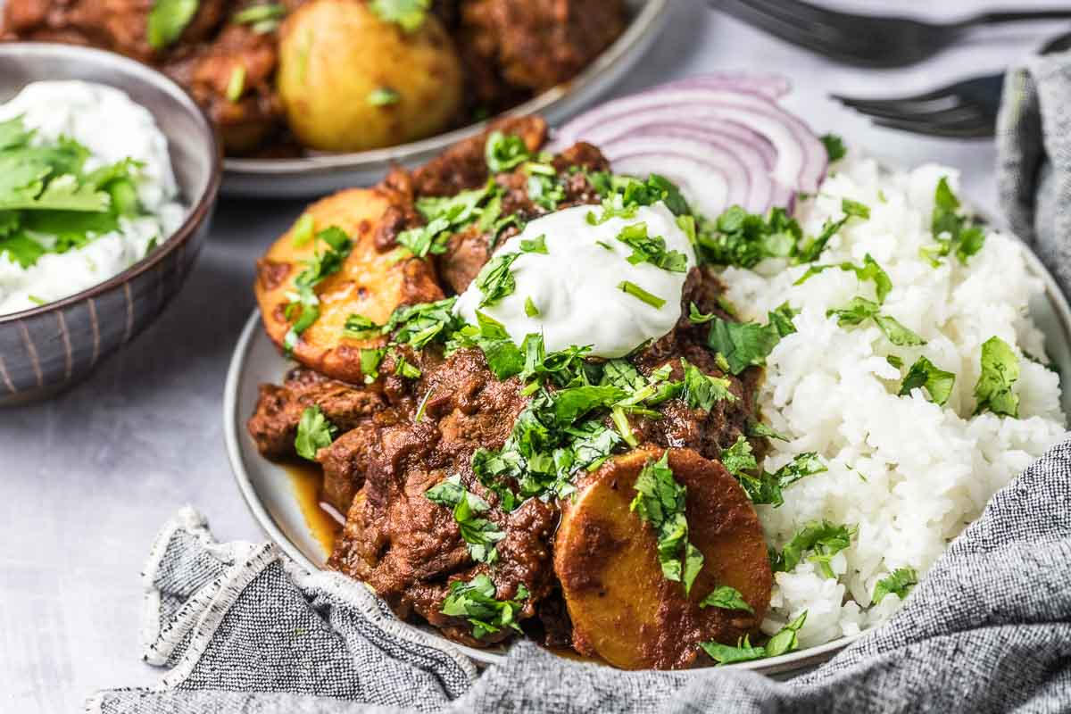 serving suggestion for lamb vindaloo, over rice with onions