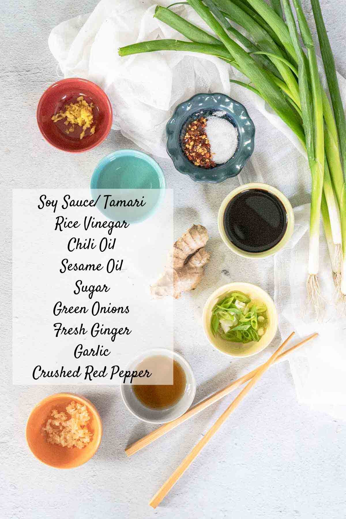 Gyoza sauce ingredients in small bowls on counter