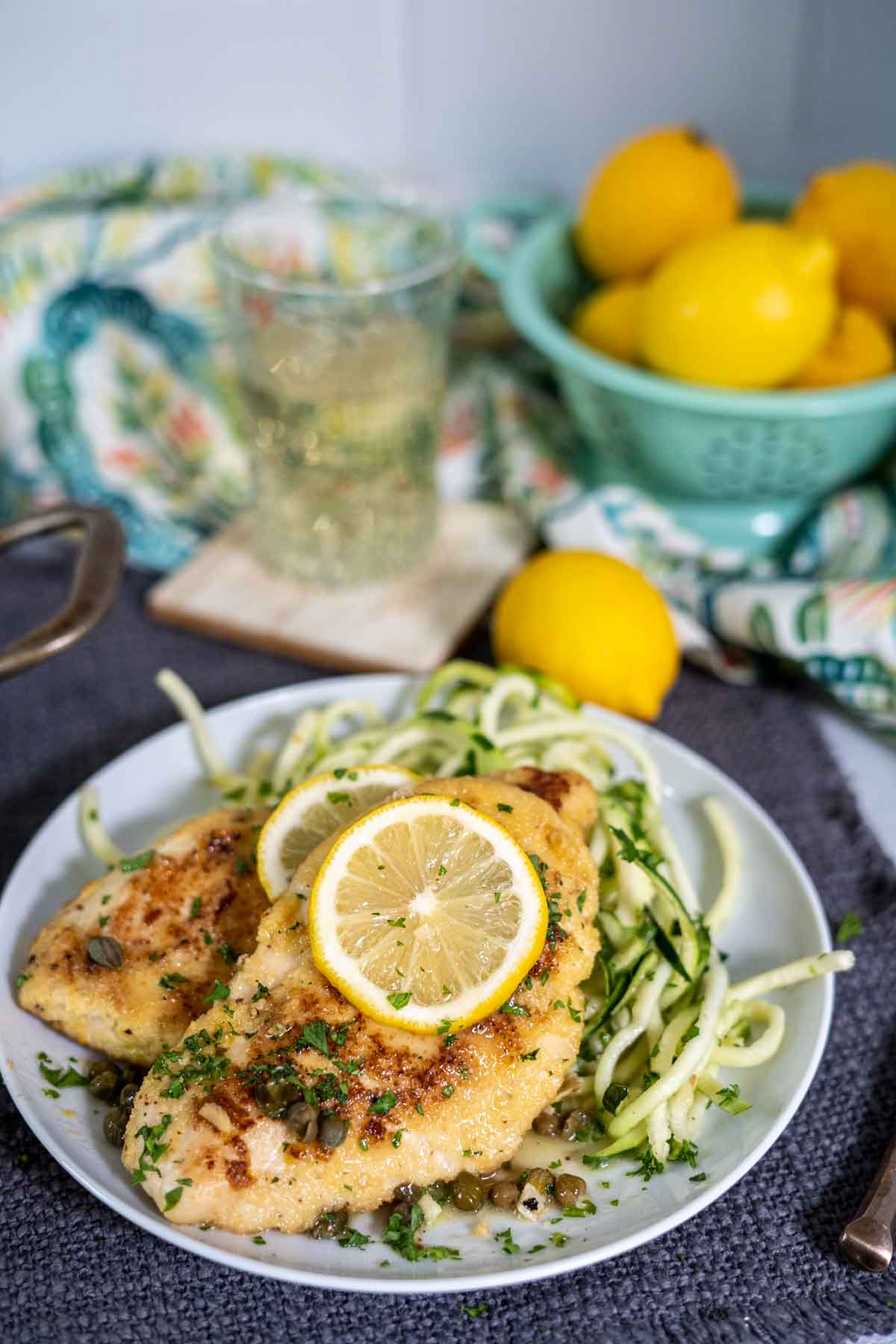 low carb chicken piccata serving over zucchini noodles
