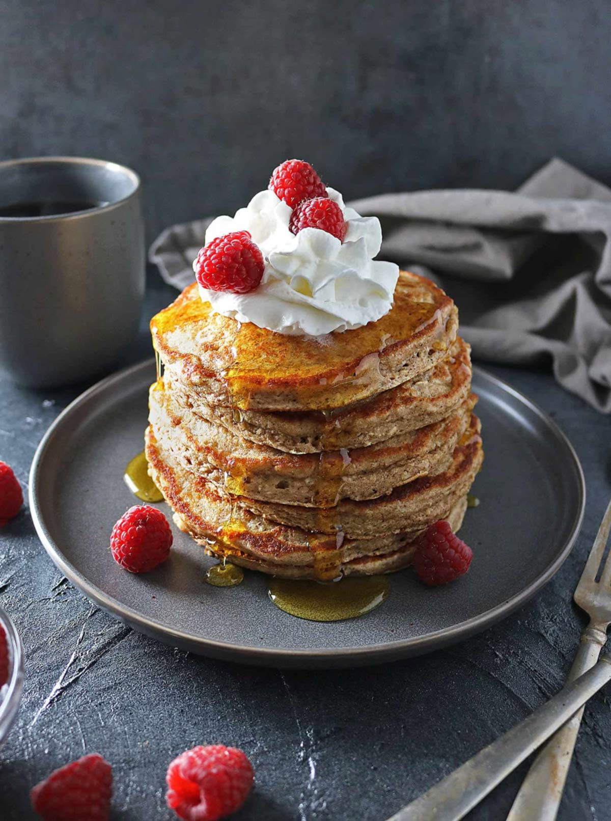 stack of oat flour pancakes with whipped cream