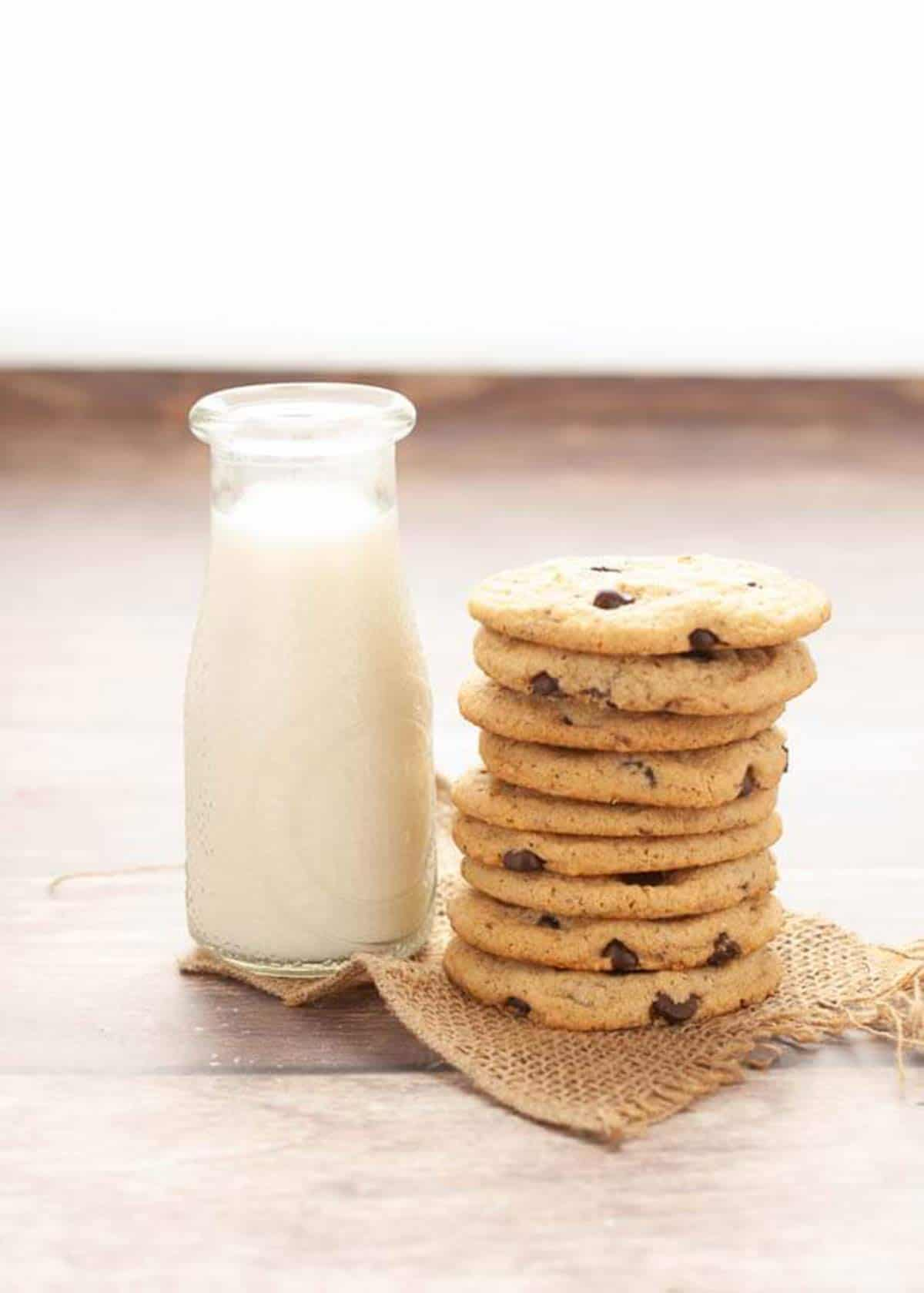 stack of cookies next to glass of milk