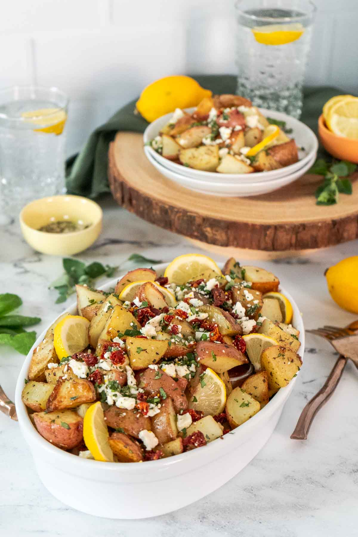 greek potatoes in serving dish
