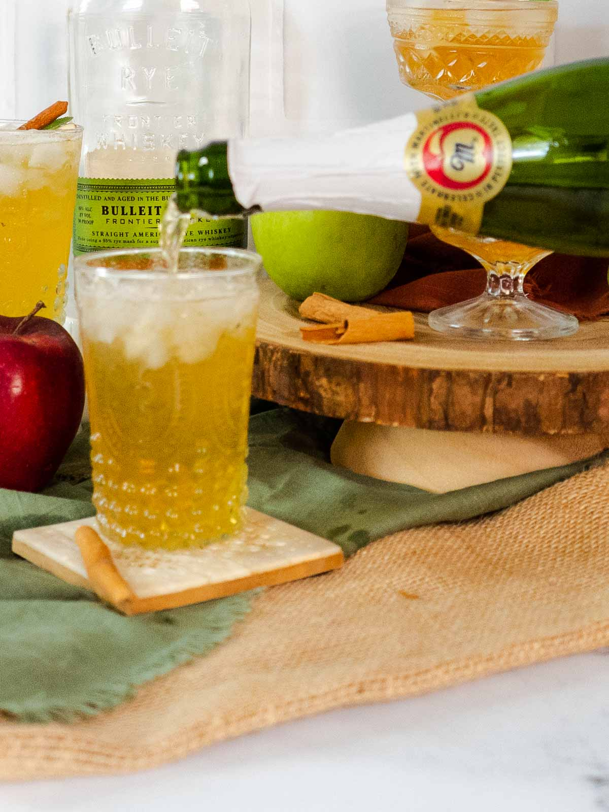 topping whiskey smash with sparkling apple cider