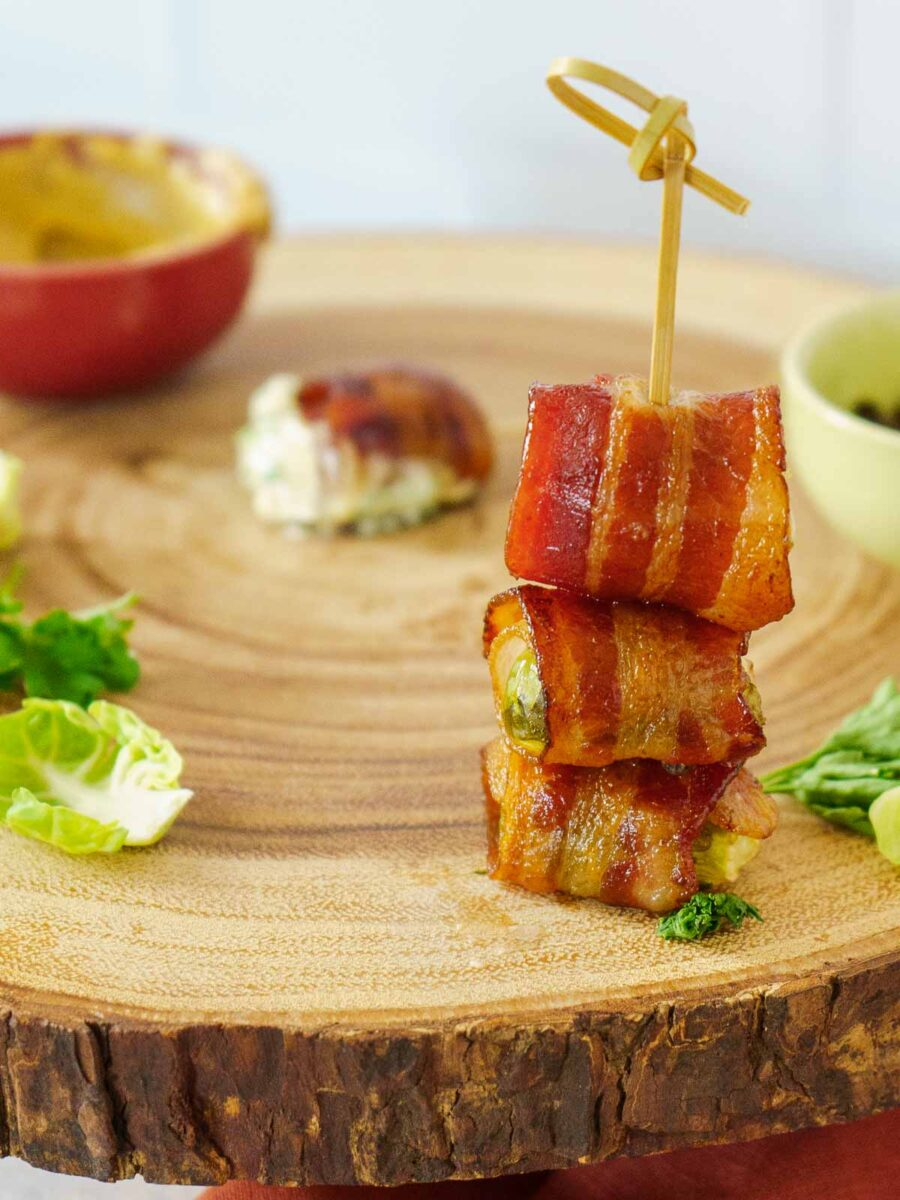 three pieces of bacon wrapped brussels sprouts stacked