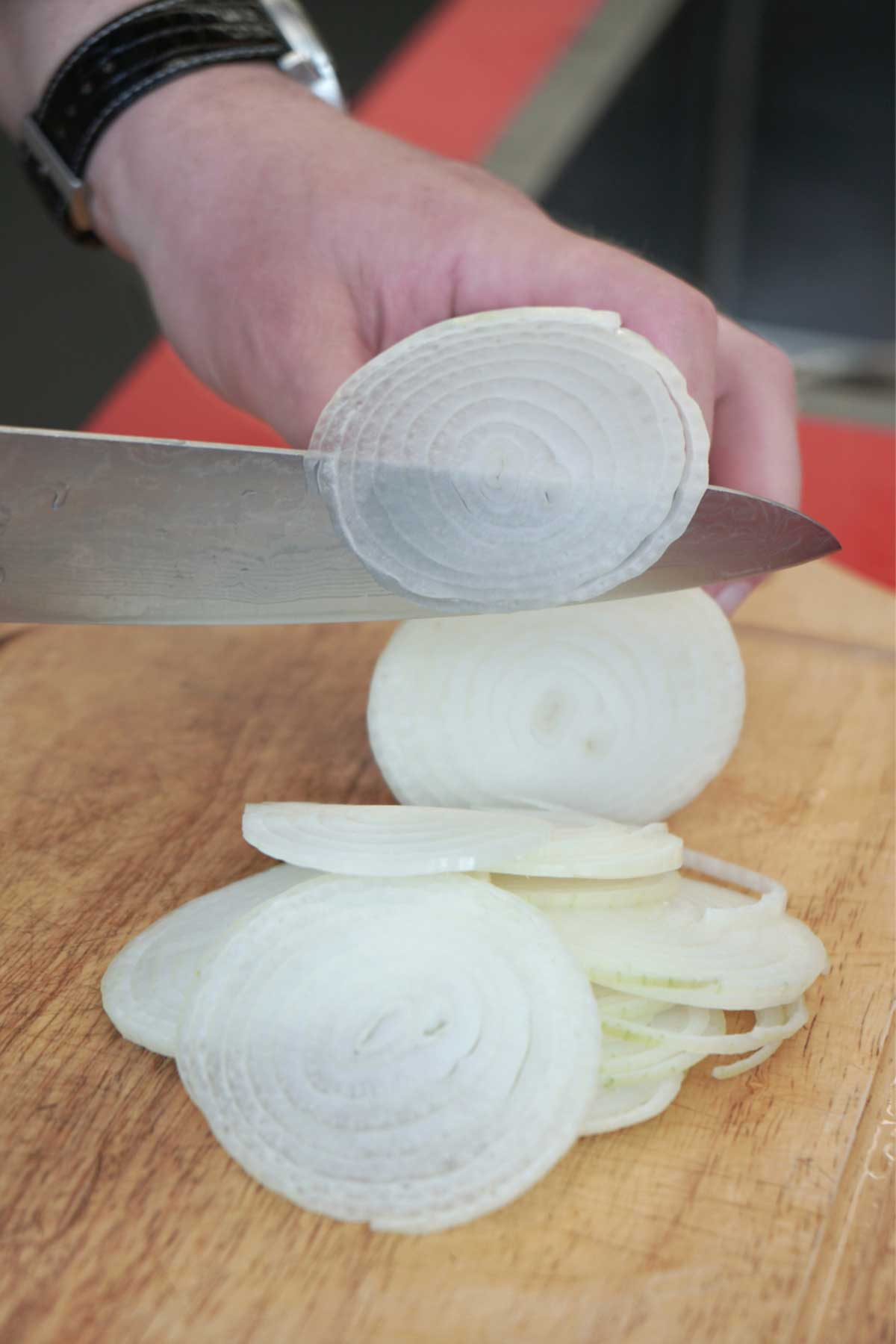 thinly slicing onions