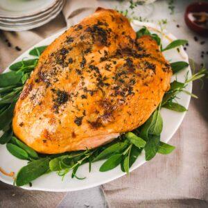 bone in double roasted turkey breast on a platter